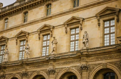 Row of Statues on the Facade of The Louvre